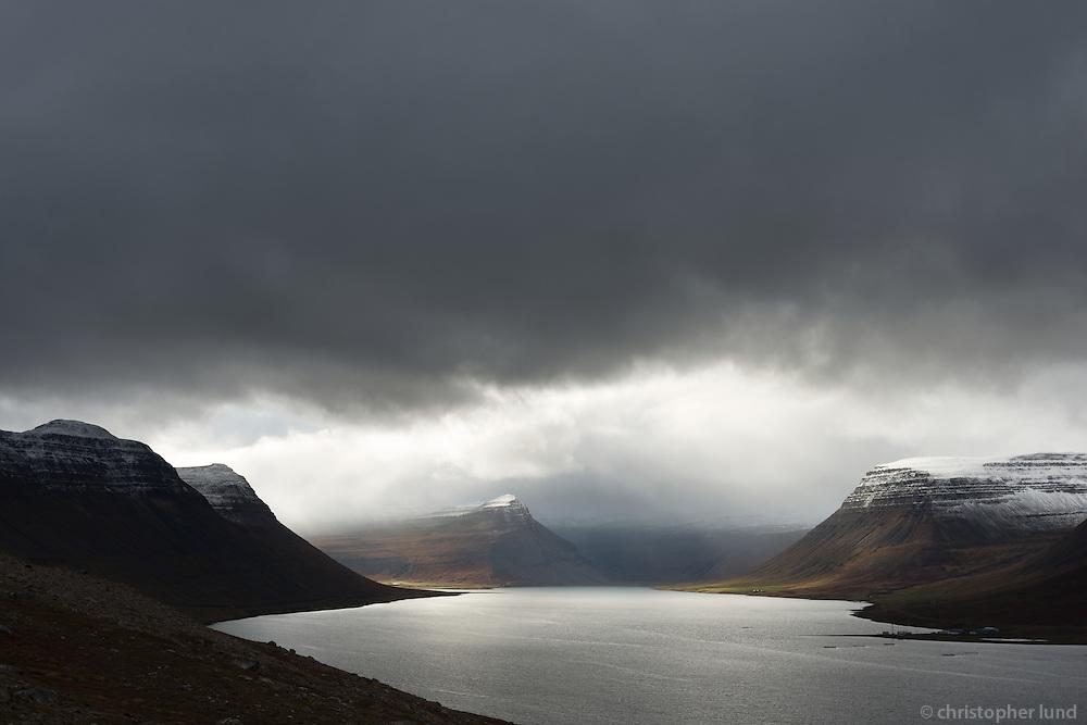 Moody light in Álftafjörður, Súðavík on the right. West fiords of Iceland.