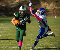 Newfound's Brett Pigeon outruns IL/MA's Deante Miller's tackle during NHIAA Division III football on Saturday afternoon.   (Karen Bobotas/for the Laconia Daily Sun)