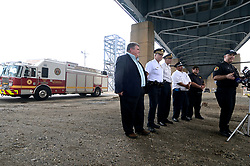 With a Hazmat apparatus as a backdrop emergency officials give updates on the ongoing emergency work after the June explosion at Philadelphia Energy Solutions, during a press conference outside the refinery on August 8, 2019.