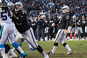 Oakland Raiders kicker Sebastian Janikowski (11) walks off the field after scoring a go-ahead field goal against the Carolina Panthers in the fourth quarter at Oakland Coliseum in Oakland, Calif., on November 27, 2016. (Stan Olszewski/Special to S.F. Examiner)