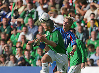 Photo: Andrew Unwin.<br />Northern Ireland v Iceland. European Championships 2008 Qualifying. 02/09/2006.<br />Iceland's Ivan Ingimarsson (R) tries to take the ball from Northern Ireland's Stephen Craigan (L).