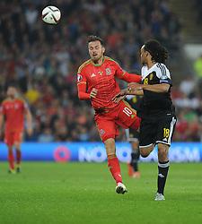 Jason Denayer of Belgium (Celtic) wins the ball over Aaron Ramsey of Wales (Arsenal) - Photo mandatory by-line: Alex James/JMP - Mobile: 07966 386802 - 12/06/2015 - SPORT - Football - Cardiff - Cardiff City Stadium - Wales v Belgium - Euro 2016 qualifier