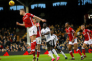 Barnsley defender Liam Lindsay (6) heads clear during the EFL Sky Bet Championship match between Fulham and Barnsley at Craven Cottage, London, England on 23 December 2017. Photo by Andy Walter.