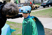 Reluctant turtle representing animals living in water encouraged by mom. MayDay Parade and Festival. Minneapolis Minnesota USA