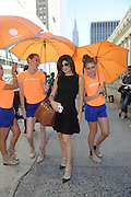 IMAGE DISTRIBUTED FOR ACCUWEATHER -  TV Personality Tamsen Fadal is shaded from the hot summer sun by the AccuWeather MinuteCast street team at New York Fashion Week, on Tuesday, Sept. 15, 2015. The AccuWeather MinuteCast Street Team is at it again helping Fashion Week attendees stay stylish and one-step ahead of any possible precipitation. (Photo by Diane Bondareff/Invision for AccuWeather/AP Images)