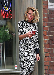 (EXCLUSIVE PICTURES) Actress Billie Piper wearing a black & white floral pattern dress and a pair of Chloé Susannah studded ankle boots visits a nail salon in north London, UK. 17/04/2014<br />BYLINE MUST READ : JAMESY/GOTCHA IMAGES<br /><br />Copyright by © Gotcha Images Ltd. All rights reserved.<br />Usage of this image is conditional upon the acceptance <br />of Gotcha Images Ltd, terms and conditions available at<br />www.gotchaimages.com