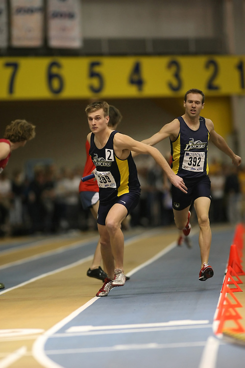 Windsor, Ontario ---13/03/09--- \cisNathan Reiter of  the University of Windsor Lancers (399) and Adam Kellar of  the University of Windsor Lancers (392)\ competes in the 4x800m Relay at the CIS track and field championships in Windsor, Ontario, March 13, 2009..Sean Burges Mundo Sport Images