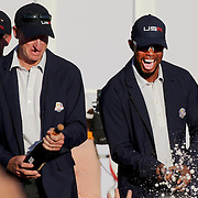 Ryder Cup 2016. Day Three. Tiger Woods and Jim Furyk of the United States spray champagne after the United States victory in the Ryder Cup tournament at Hazeltine National Golf Club on October 02, 2016 in Chaska, Minnesota.  (Photo by Tim Clayton/Corbis via Getty Images)