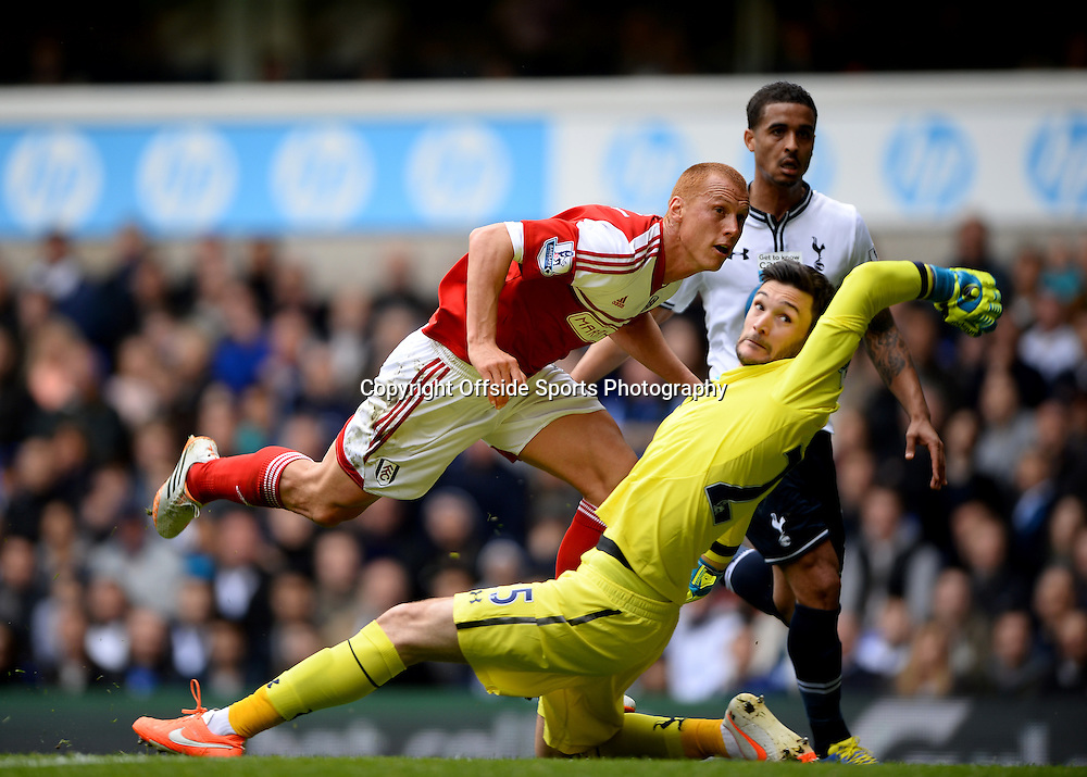 19 April 2014 - Barclays Premier League - Tottenham Hotspur v Fulham - Steve Sidwell of Fulham lifts the ball over Hugo Lloris of Tottenham Hotspur to score the equalising goal - Photo: Marc Atkins / Offside.