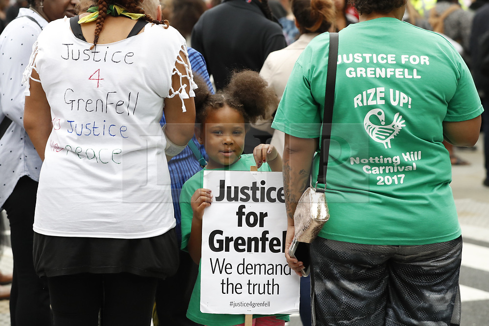 © Licensed to London News Pictures. 14/08/2017. London, UK. People march in silence to remember the victims of the Grenfell fire.  The silent march takes place every month to remember the 80 residents of the 24 storey tower block that died in the tragedy on June 12, 2017 in Kensington. Photo credit: Peter Macdiarmid/LNP