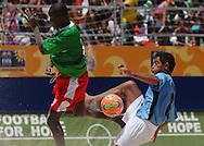 Football-FIFA Beach Soccer World Cup 2006 - Group C-CAM_URU - A ball figth between Miguel-URU- and Nyamsi-CAM. - Rio de Janeiro - Brazil 06/11/2006<br />Mandatory credit: FIFA/ Marco Antonio Rezende.
