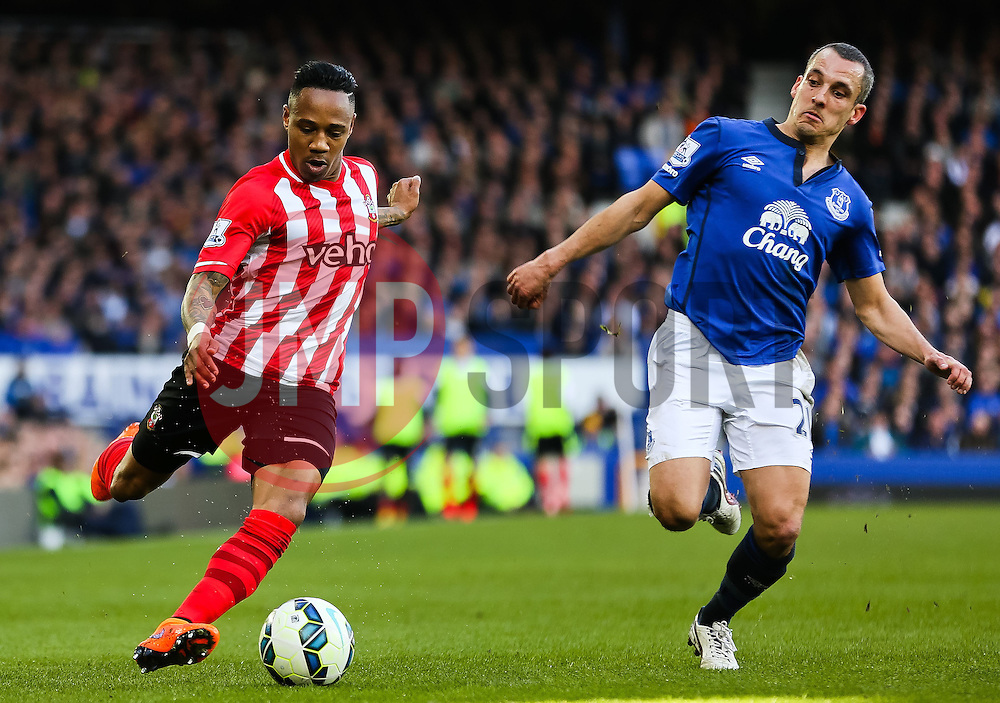Southampton's Nathaniel Clyne crosses under pressure from Everton's Leon Osman- Photo mandatory by-line: Matt McNulty/JMP - Mobile: 07966 386802 - 04/04/2015 - SPORT - Football - Liverpool - Goodison Park - Everton v Southampton - Barclays Premier League