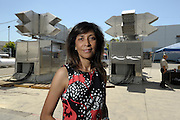 Kusum Kavia with the Spirit 1 MW Turbine Power Generation System at Combustion Associates, Inc. in Corona, CA 8/17/2015 (photo by John McCoy)