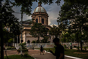 A young resident uses his cell phone as he walks past the Pantheon de los Heroes, a national monument to the heroes of the nation, among them the children that died fighting a battle during the Paraguayan war in the 19th century in Asuncion, Paraguay, Friday, Dec.15, 2017. Paraguay today is trying to promote a positive image of Guaraní. But centuries of subjugation have rendered it a second class language in the minds of many Paraguayans. (Dado Galdieri for The New York Times)
