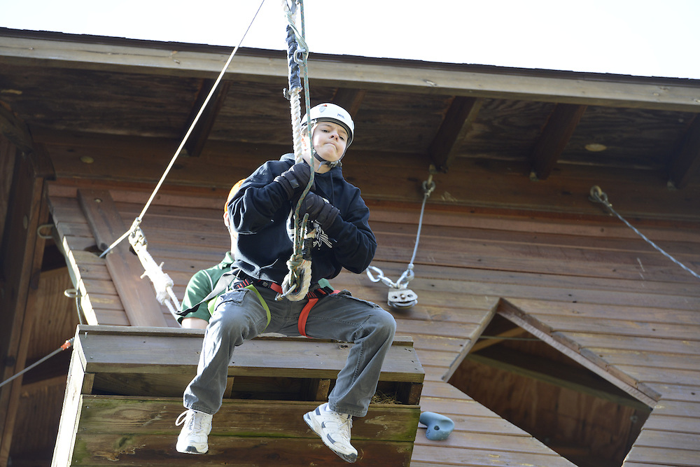 Ethan Scarberry enjoys the zipline during his time at Sibs Weekend 2015.