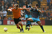 Wolverhampton Wanderers midfielder James Henry turns Sheffield Wednesday midfielder Lewis McGugan during the Sky Bet Championship match between Wolverhampton Wanderers and Sheffield Wednesday at Molineux, Wolverhampton, England on 7 May 2016. Photo by Alan Franklin.