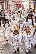 Young girls dressed as angels walk in a religious procession from the Parroquia de San Miguel Arcangel church at the start of the week long fiesta of the patron saint Saint Michael  September 21, 2017 in San Miguel de Allende, Mexico.