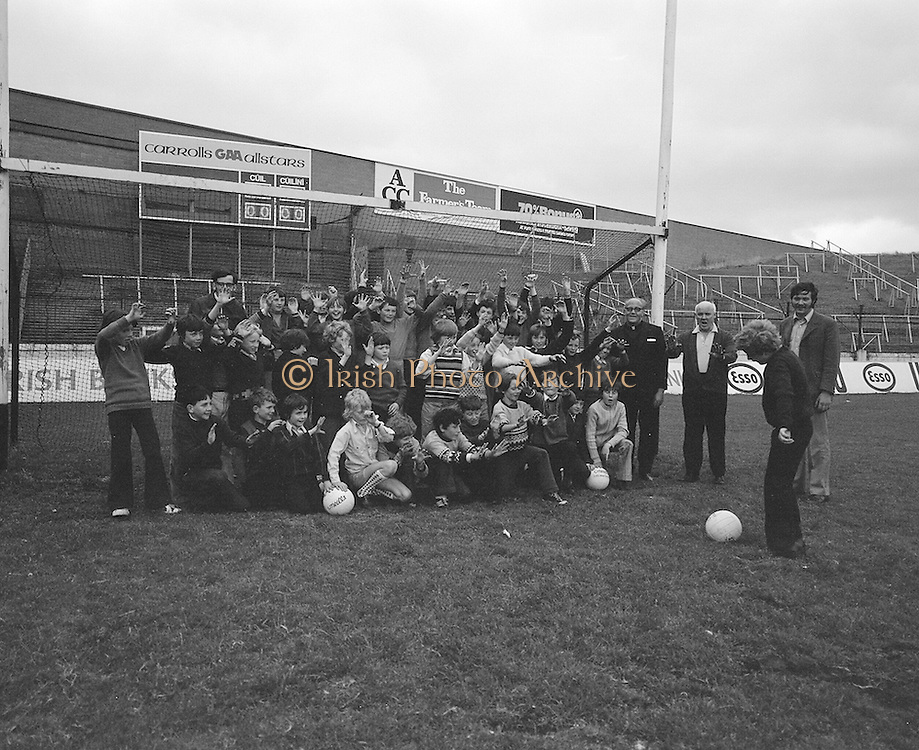 A tour group pose for a photograph in the goalmouth during a visit to Croke park on the 4th of July 1974.