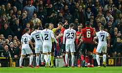 MANCHESTER, ENGLAND - Tuesday, February 12, 2019: Paris Saint-Germain and Manchester United clash after Ashley Young pushed Ángel Di María off the pitch and into metal railings during the UEFA Champions League Round of 16 1st Leg match between Manchester United FC and Paris Saint-Germain at Old Trafford. (Pic by David Rawcliffe/Propaganda)