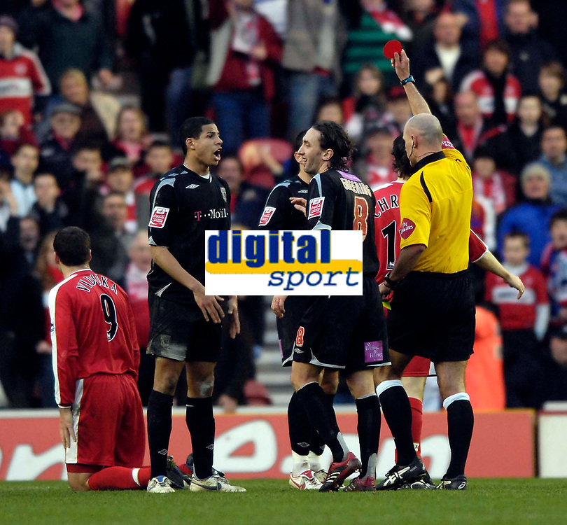Photo: Jed Wee/Sportsbeat Images.<br /> Middlesbrough v West Bromwich Albion. The FA Cup. 17/02/2007.<br /> <br /> Referee Howard Webb sends West Brom's Curtis Davies (L) off after picking up two yellow cards.