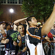 Miles Thompson #74 of the Rochester Rattlers takes a selfie with some fans following the game at Harvard Stadium on August 9, 2014 in Boston, Massachusetts. (Photo by Elan Kawesch)