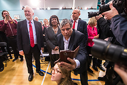 © Licensed to London News Pictures . 22/03/2018. Manchester, UK. JEREMY CORBYN , DIANE ABBOTT and JOHN HEALEY and a photobombing selfie-seeker . Jeremy Corbyn and Shadow Cabinet members launch the Labour Party's local election campaign at Stretford Sports Village in Trafford . Photo credit: Joel Goodman/LNP