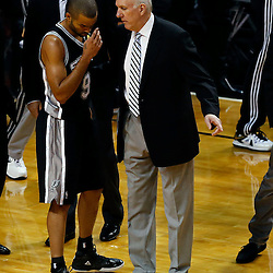 Jun 20, 2013; Miami, FL, USA; San Antonio Spurs head coach Gregg Popovich talks to San Antonio Spurs point guard Tony Parker (9) during the first quarter of game seven in the 2013 NBA Finals at American Airlines Arena. Mandatory Credit: Derick E. Hingle-USA TODAY Sports
