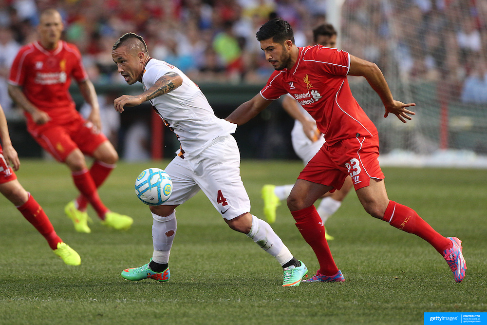 Radja Nainggolan, (left), Roma, is challenged by Emre Can, Liverpool, during the Liverpool Vs AS Roma friendly pre season football match at Fenway Park, Boston. USA. 23rd July 2014. Photo Tim Clayton
