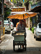 11 AUGUST 2016 - BANGKOK, THAILAND: A street food vendor pushes his cart through the Talat Noi neighborhood in Bangkok. Talat Noi is next to Chinatown and is one the best preserved traditional neighborhoods in Bangkok.      PHOTO BY JACK KURTZ