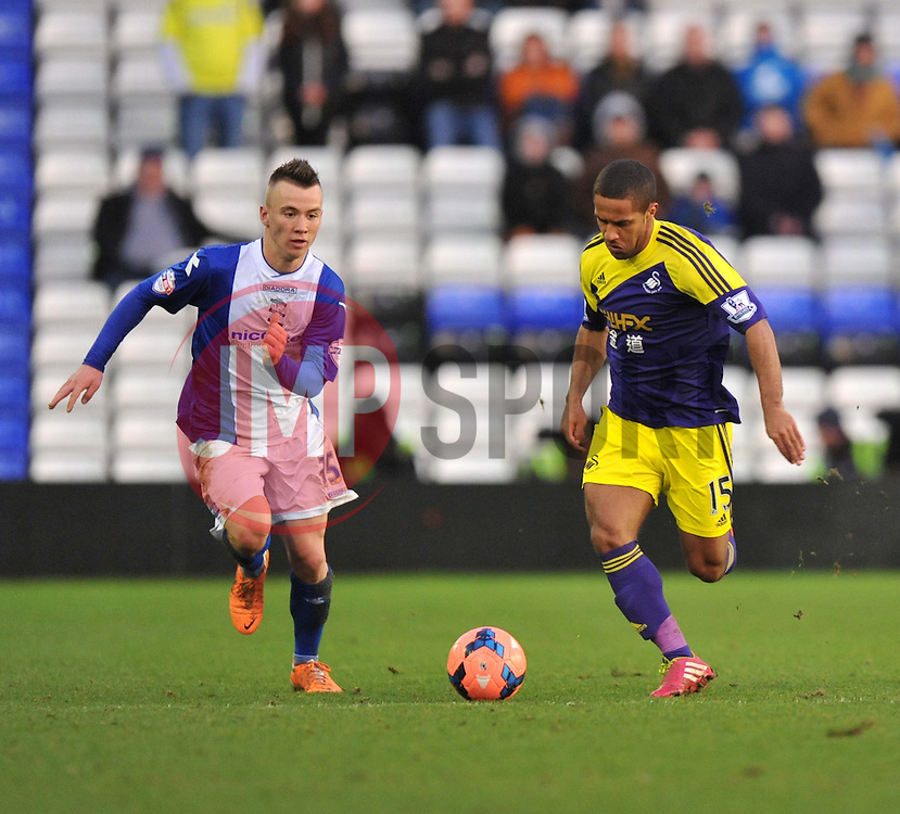 Birmingham City's Wade Elliott looks to chase down Swansea City's Wayne Routledge - Photo mandatory by-line: Alex James/JMP - Tel: Mobile: 07966 386802 25/01/2014 - SPORT - FOOTBALL - St Andrew's - Birmingham - Birmingham City v Swansea City - FA Cup - Forth Round