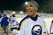 Matthew Barnaby laughs as he leaves the ice between periods of the Amerks vs. Sabres alumni game at Frontier Field in Rochester on Sunday, December 15, 2013.