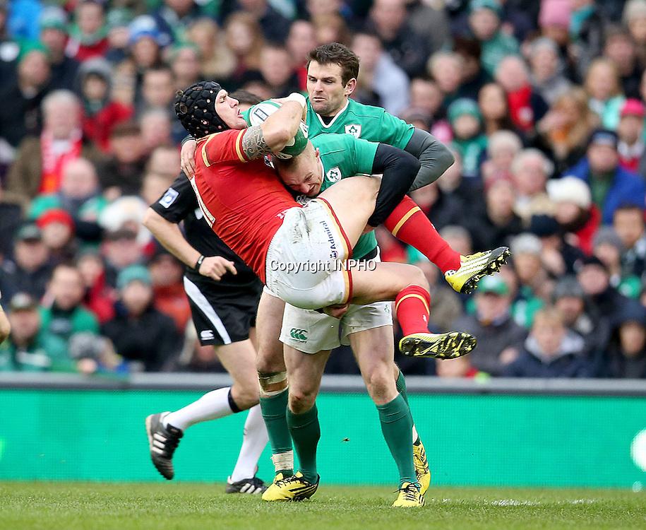 RBS 6 Nations Championship Round 1, Aviva Stadium, Dublin 7/2/2016<br /> Ireland vs Wales<br /> Ireland's Keith Earls tackles Tom James of Wales <br /> Mandatory Credit &copy;INPHO/Dan Sheridan