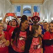 From right, Wyoming County's Mullens Elementary school teachers Kara Brown, Katherine Dudley and Nina Tunstalle, along with Lois Casto of Central Elementary school in St. Albans, react to news of a deal reached between the House and Senate for a 5% across the board increase for state workers at the capitol in Charleston, W.V., on Tuesday, March 06, 2018; the ninth day of statewide school closures.