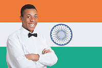 Portrait of mixed race man against Indian flag