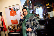 Roya Sadat, 28, a documentary and fiction filmmaker, is speaking on the phone in her home in Kabul, Afghanistan. Roya's most famous production is titled 'Three Dots', an award-winning film that tells the story of women's village life in the province of Herat in western Afghanistan.