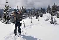 Backcountry skier taking photos in Manning Provincvial Park British Columbia Canada