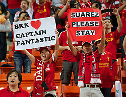 BANGKOK, THAILAND - Sunday, July 28, 2013: Liverpool supporters with banners 'Captain Fantastic' and 'Suarez Please Stay' during a preseason friendly match against Thailand XI at the Rajamangala National Stadium. (Pic by David Rawcliffe/Propaganda)