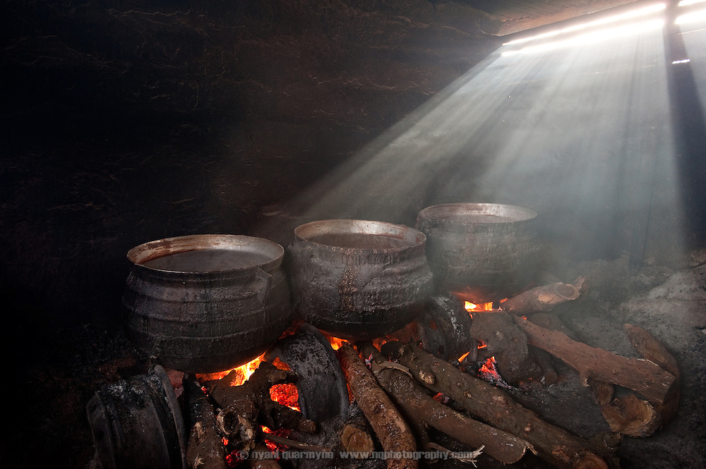 Large cauldrons of pito, an alcoholic beverage made from millet in Agbogbloshie, a slum in Ghana's capital, Accra.