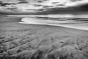 Dramatic black-and-white beach in Corolla on the Outer Banks of NC.
