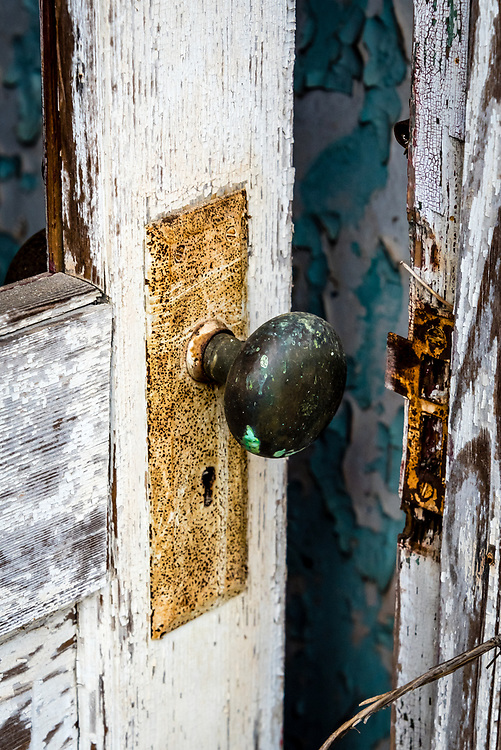 Cool textures are featured in this detail of the front door of an abandoned old house. The image was processed in Exposure 7 to emulate Kodachrome 25 slide film