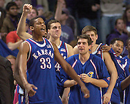 C. J. Giles (33) and his Kansas teammates celebrate as they beat Kansas State 66-52 at Bramlage Coliseum in Manhattan, Kansas, March 4, 2006.