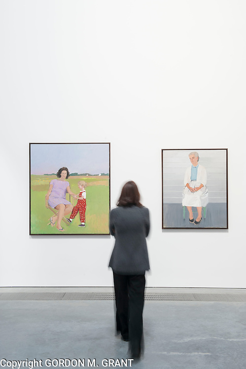 An employee of the Parrish Art Museum looks at works by Fairfield Porter in one of the museum's new galleries at it's new building in Water Mill. (October 22, 2012)