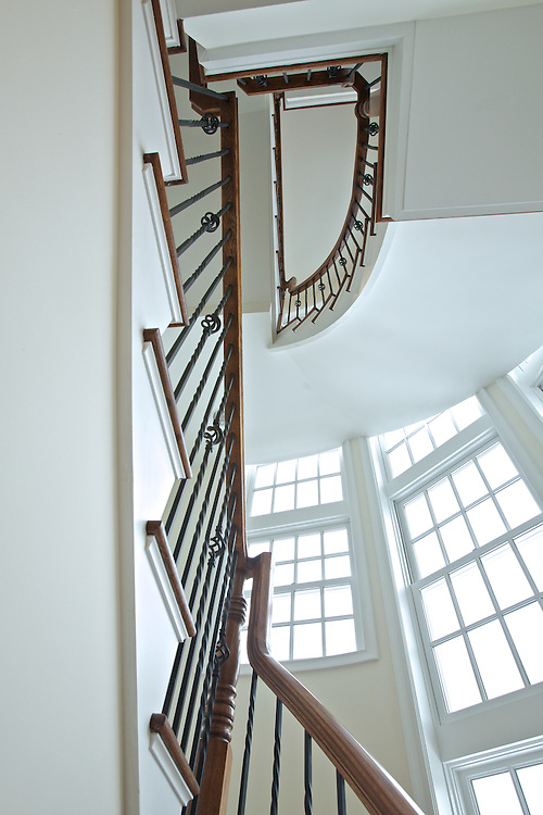 An architectural shot of a staircase of one of the beautiful town homes the the Residences of Palmer Square
