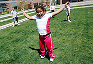Fernanda Garcia-Villanueva does jumping jacks at a group exercise session in the 10-week Shapedown Program at The Children's Hospital in Aurora, Colorado May 29, 2010.  The program is part of the child and teen weight management program at the hospital. REUTERS/Rick Wilking (UNITED STATES)