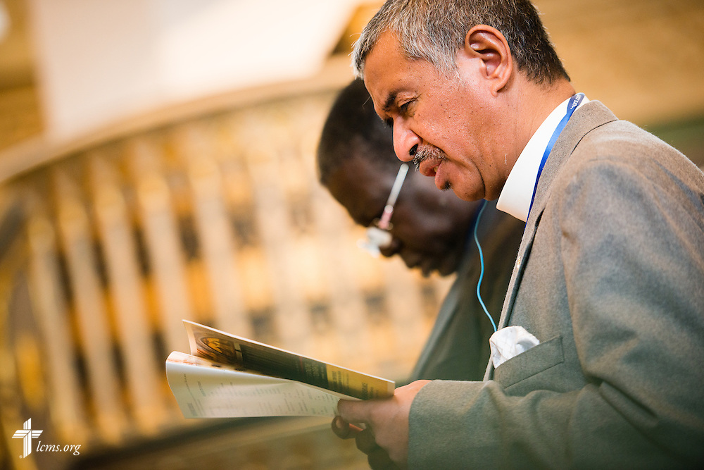 Fiangonana Loterana Malagasy (FLM) Bishop David Rakotonirina of Madagascar sings during Matins at the Town and Parish Church of St. Mary's during the International Conference on Confessional Leadership in the 21st Century in Wittenberg, Germany. LCMS Communications/Erik M. Lunsford