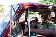 Havana, Cuba,December 18, 2014: tenor sax man Alfredo Thompson in  Thompson's 1960s Russian Lada car. 12/18/2014 (Photo: Ann Summa).