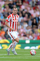 """Stoke City's Charlie Adam during the Barclays Premier League match at the Britannia Stadium, Stoke-on-Trent. PRESS ASSOCIATION Photo. Picture date: Sunday August 9, 2015. See PA story SOCCER Stoke. Photo credit should read: Martin Rickett/PA Wire. EDITORIAL USE ONLY. No use with unauthorised audio, video, data, fixture lists, club/league logos or """"live"""" services. Online in-match use limited to 45 images, no video emulation. No use in betting, games or single club/league/player publications."""