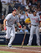 ATLANTA, GA - AUGUST 30:  Third baseman Ryan Zimmerman #11 of the Washington Nationals follows through after making contact for a three run home run while teammate Michael Morse #38 reacts in the background during the game against the Atlanta Braves at Turner Field on August 30, 2011 in Atlanta, Georgia.  (Photo by Mike Zarrilli/Getty Images)