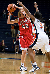 Richmond forward Rebecca Kretchman (40) is guarded by Virginia guard Paulisha Kellum (3).  The Virginia Cavaliers women's basketball team faced the Richmond Spiders at the John Paul Jones Arena in Charlottesville, VA on November 18, 2007.