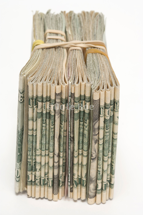 a stack with various dollar bills hold together with rubber band strings
